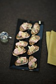 Crostini with veal liver pate and candied ginger strips