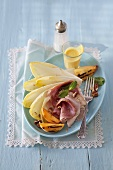 Smoked ham with grilled peach and chicory leaves