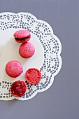 Raspberry macaroons on a paper doily