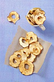 Organic apple chips on baking paper