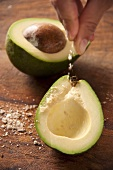 Fleur de Sel being sprinkled onto an avocado