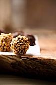 Crispy truffle pralines on a piece of paper