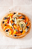 Fruit tart with sugared herbs