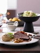 Roast venison with Tyrol bacon and bread dumplings