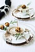 Cream of mushroom soup with mushroom bread dumplings for Christmas