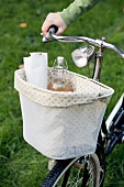 Drinks in a bicycle basket for a picnic