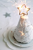 A Christmas tree cake with a sparkler