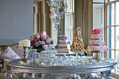 A cake buffet with wedding cakes