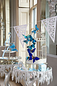 Wedding decoration: a bird cage with butterflies