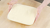 Tiramisu (without cocoa powder) in a rectangular dish