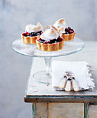 Berry tarts with meringue topping