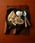 Coconut pancakes with chocolate sauce and vanilla ice cream