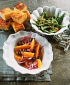 Orange salad with onions and olives, cornbread & bean salad