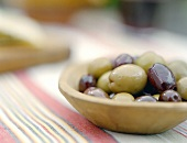 Mixed Olives in a Bowl on a Striped Towel