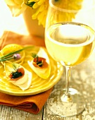 Chicory leaves with caviare; glass of white wine
