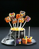 Halloween Face Lollipops in a Bowl of Candy Corns