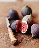 Organic Figs; One Cut in Half; Knife