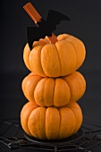 Three Mini Pumpkins Stacked as Halloween Decoration