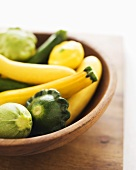 Variety of Organic Summer Squash in a Wooden Bowl