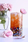 Tall Glass of Rose Hip Iced Tea with Pink Roses
