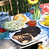 Grilled Brisket on Picnic Table with Sides