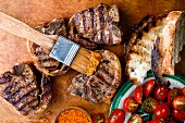 Grilled Lamb Chops with Tomato Salad and Bread; Basting Sauce and Brush