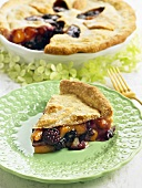 Slice of Blackberry Peach Pie on a Pretty Green Plate; Whole Pie