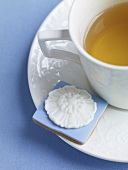 Cup of Tea with Pretty Blue and White Tea Cookie