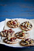 Cookies Topped with Pistachios, Dried Fruit and Chocolate Drizzles