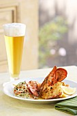 Grilled lobster with coleslaw and a glass of beer