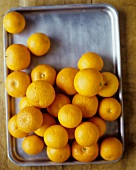 Whole Oranges on a Baking Sheet