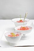 Bowls of woodruff and strawberry jelly