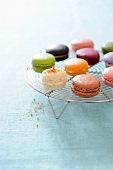 Various macaroons on a wire rack