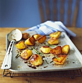 Roasted potatoes with rosemary on a baking tray