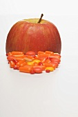 Vitamin tablets and an Elstar apple