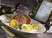 Beef fillet in a herb crust with pear-filled ravioli