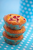 A stack of three redcurrant muffins