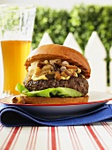 Hamburger with Stilton, caramelized shallots and mushrooms, with beer