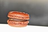 Orange macaroon with chocolate cream filling
