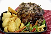 Roasted leg of lamb with rosemary, potatoes and vegetables