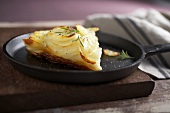 Wedge of Potato Gratin on a Skillet