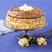 Chocolate almond cake on cake stand