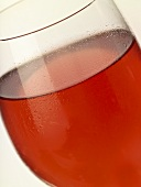 A glass of rosé wine with condensation (close-up)