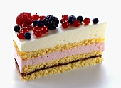 A piece of strawberry cream cake with wild strawberries