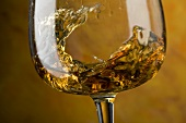 Swirling cognac in glass (close-up)