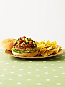 Turkey burger with avocado relish and nachos