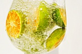 Citrus fruits in a glass of water