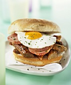Sausage, bacon and fried egg sandwich