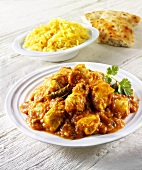 Chicken curry, rice and flatbread (India)