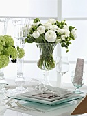 A festive flower arrangement and white buttercups